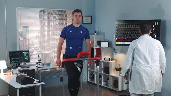Cardiologist Coming to Monitor Athlete's Stress Testing on Treadmill