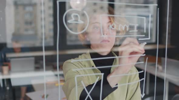 Female UI Designer Drawing Ideas for App Interface