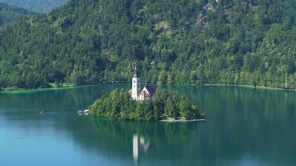 Secluded Island With Church Surrounded by Lake Bled and Alps Spirituality