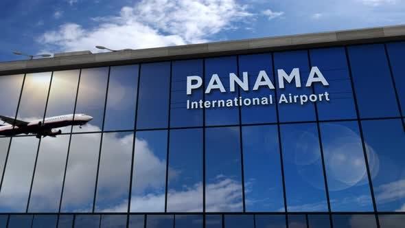 Airplane landing at Panama airport mirrored in terminal