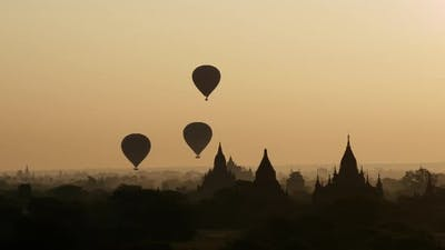 Balloons flying during sunrise over the Pagodas