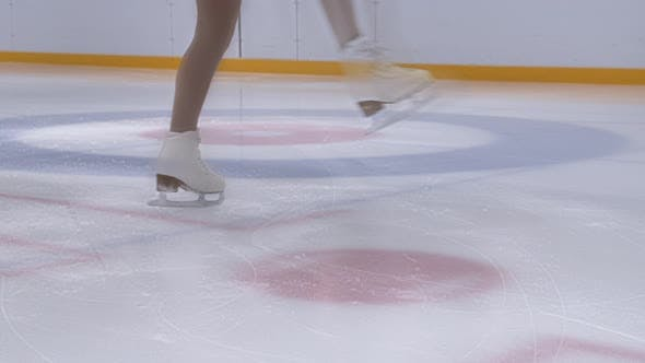 Thumbnail for Young Ice Skater Spinning On Ice Rink