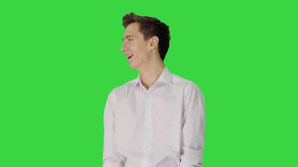 Thumbnail for Handsome Young Man Laughing Out Loud on a Green Screen Chroma Key