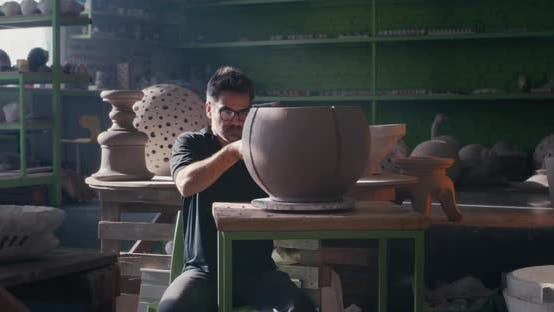 Potter Creating Ornament on Clay Bowl