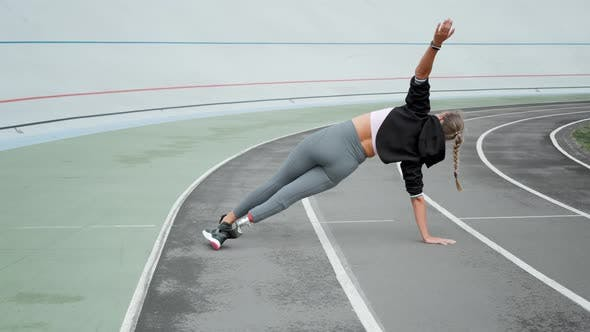 Thumbnail for Disabled Athlete Standing in Plank on Hand at Track. Girl Practicing Yoga