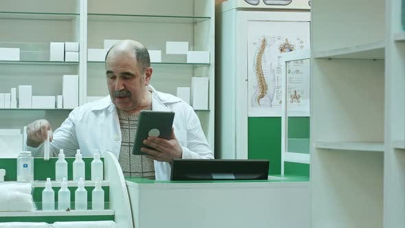 Thumbnail for Senior Pharmacist Having Video Chat with Client Using Tablet Pc in Drug Store