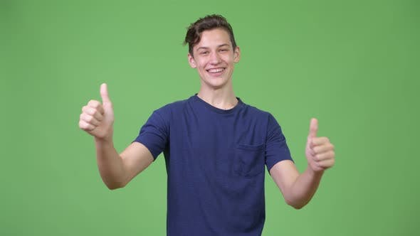 Thumbnail for Young Handsome Teenage Boy Giving Thumbs Up