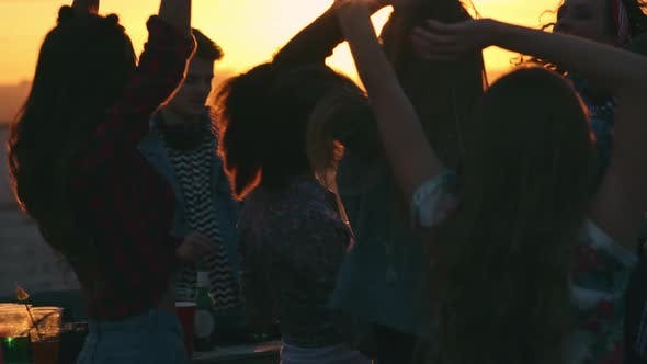 Thumbnail for Young People Dancing at Rooftop Party