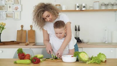 Mother and Son Cut Vegetables Together