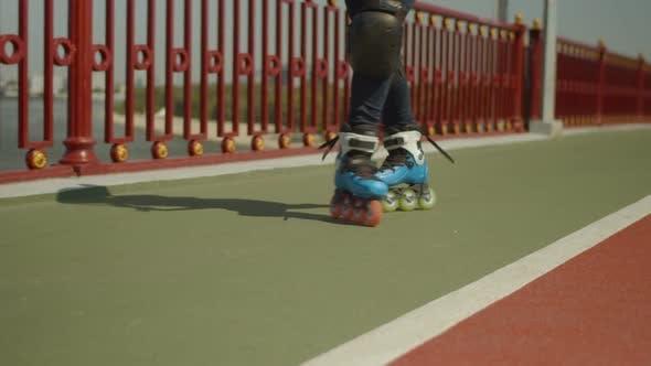 Thumbnail for Legs of Woman Roller Skating Backwards on Bridge