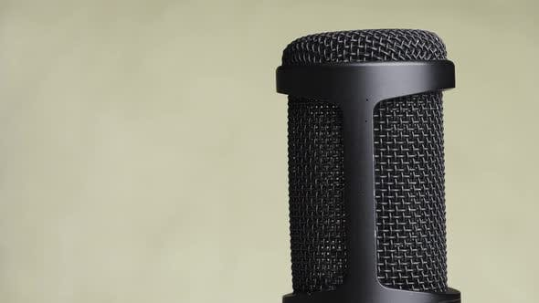 Thumbnail for Studio Condenser Microphone Rotates on Yellow Background with Place for Text
