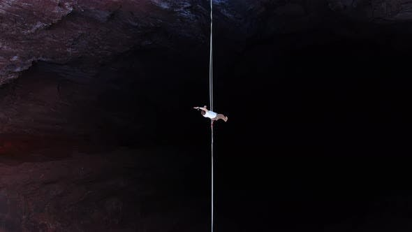 Extreme Sport of Slacklining Top View on a Man Walking the Tightrope