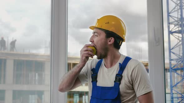 Thumbnail for Construction Worker Having a Break and Eating Apple.
