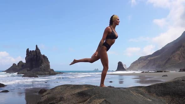 Thumbnail for Girl Doing Yoga Balancing on One Leg Standing on a Stone. Peace of Mind. Healthy Lifestyle. Balance
