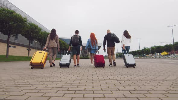 Thumbnail for Five Traveling Friends Head To the Airport Terminal with Luggage in Hand. Tourists and Travelers Go