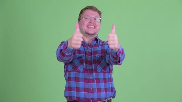 Thumbnail for Happy Overweight Bearded Hipster Man Giving Thumbs Up and Looking Excited