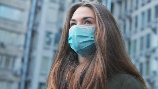 Thumbnail for Bottom Side View of Exhausted Brunette Woman in Protective Mask Standing Outdoors. Close-up of Young