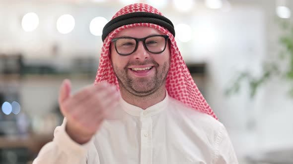 Thumbnail for Assertive Young Arab Businessman Pointing with Finger and Inviting