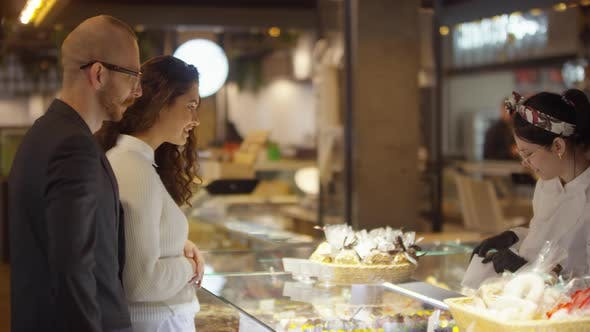Thumbnail for Couple Buying Macarons in Food Mall