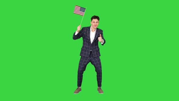 Thumbnail for Young Man in Formal Suit Dancing in a Funny Way with American Flag on a Green Screen, Chroma Key