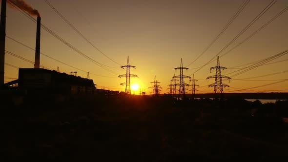 Electric tower of high voltage. Aerial view of high voltage power lines silhouette