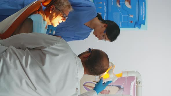 Vertical Video Professional Dentist Working with Gloves During Examination