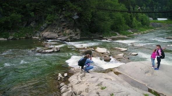 Thumbnail for People Near Beautiful Flowing Water