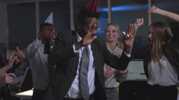 Thumbnail for African Businessman Dancing with Coworkers at Corporate Party