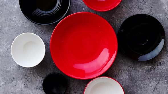 Thumbnail for Collection of Empty Colorful Decorative Ceramic Bowls on Grey Stone Background.