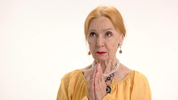 Senior Woman Praying Isolated