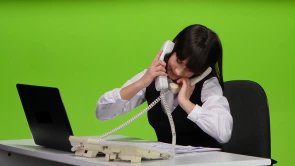 Thumbnail for Woman Office Worker Talk on Two Phones at Once