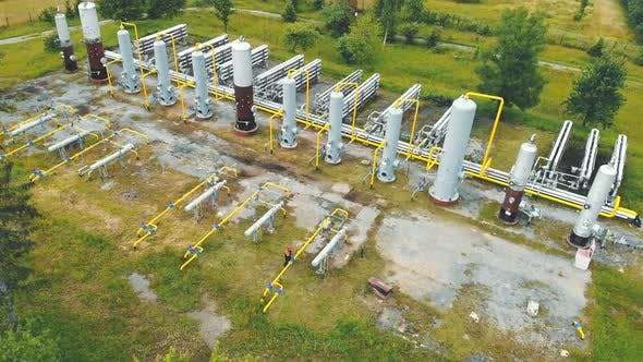 Thumbnail for Aerial View Gas Production. Large Gas Distribution Complex. A Gas Worker or a Station Operator Shuts