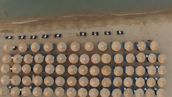 Cover Image for Flying Over Empty Sunbeds at Seaside in the Morning