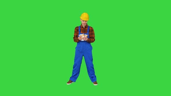 A Workman Counting Cash in Exaggerated Way and Dancing After That on a Green Screen, Chroma Key