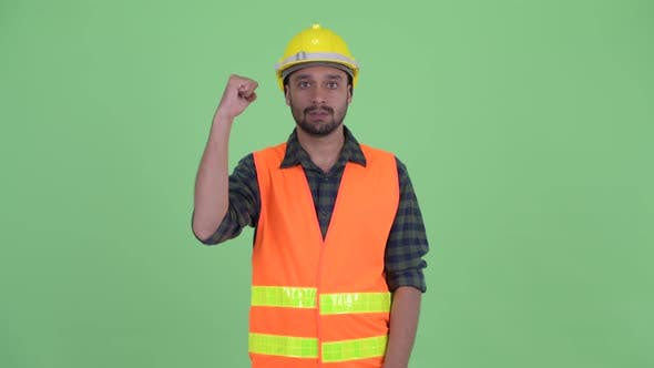 Thumbnail for Happy Young Bearded Persian Man Construction Worker with Fist Raised