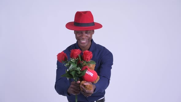 Cover Image for Young Happy African Businessman Giving Gifts Ready for Valentine's Day