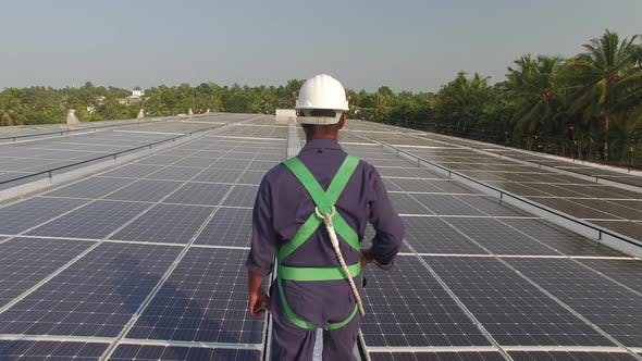 Thumbnail for Construction Worker Walks on a Solar Panel Roof