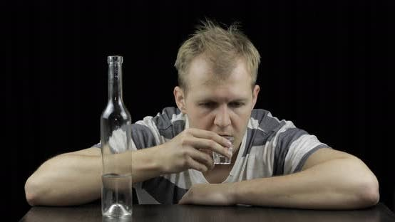 Thumbnail for Depressed Man Drinking Vodka Alone in a Dark Room. Concept of Alcoholism
