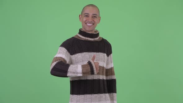 Thumbnail for Happy Bald Multi Ethnic Man Giving Thumbs Up Ready for Winter