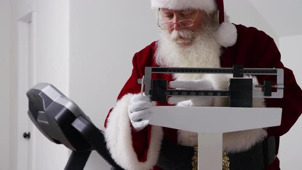 Santa Claus upset to see weight on scale