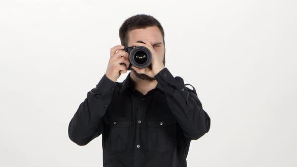 Thumbnail for Photographer Holds the Photography. White