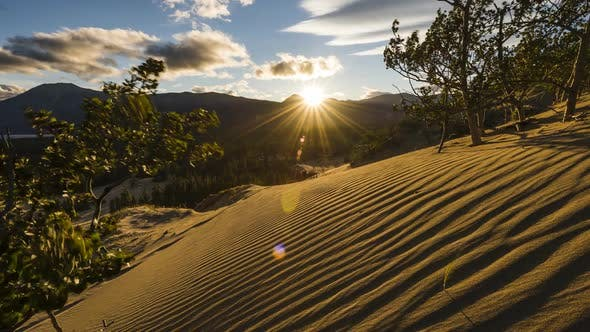 Thumbnail for Sunset Over Sand Dunes in Mountains of Yukon  Time Lapse