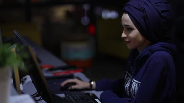 Woman Works On Office Computer