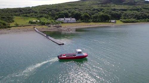A Passenger Ferry Departing a Pontoon