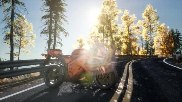 Thumbnail for Sportbike on Tre Road in Forest with Sun Beams