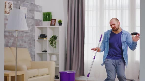 Thumbnail for Guy Dancing and Cleaning