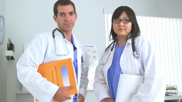 Thumbnail for Two doctors standing in the office