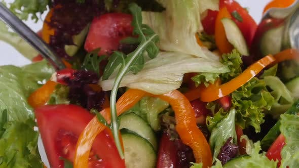 Thumbnail for Fresh Mixed Vegetables Falling Into Bowl of Salad Isolated on White. Slow Motion.