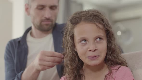 Thumbnail for Dad Braids Curly Hair Cute Little Daughter. Family Relationships.