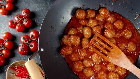 Thumbnail for Meatballs Are Fried in a Pan with Tomatoes.
